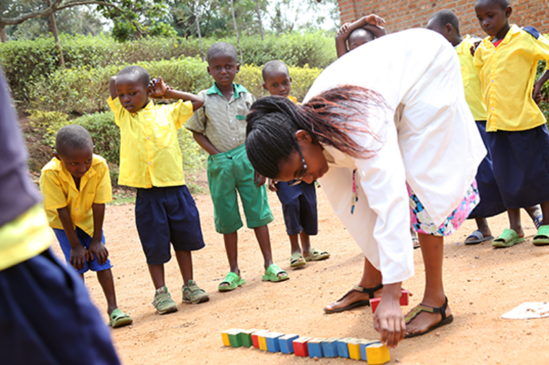 Right To Play-trained teacher Christine uses our play-based methodology to keep her students engaged and active in her classroom in Rwanda.