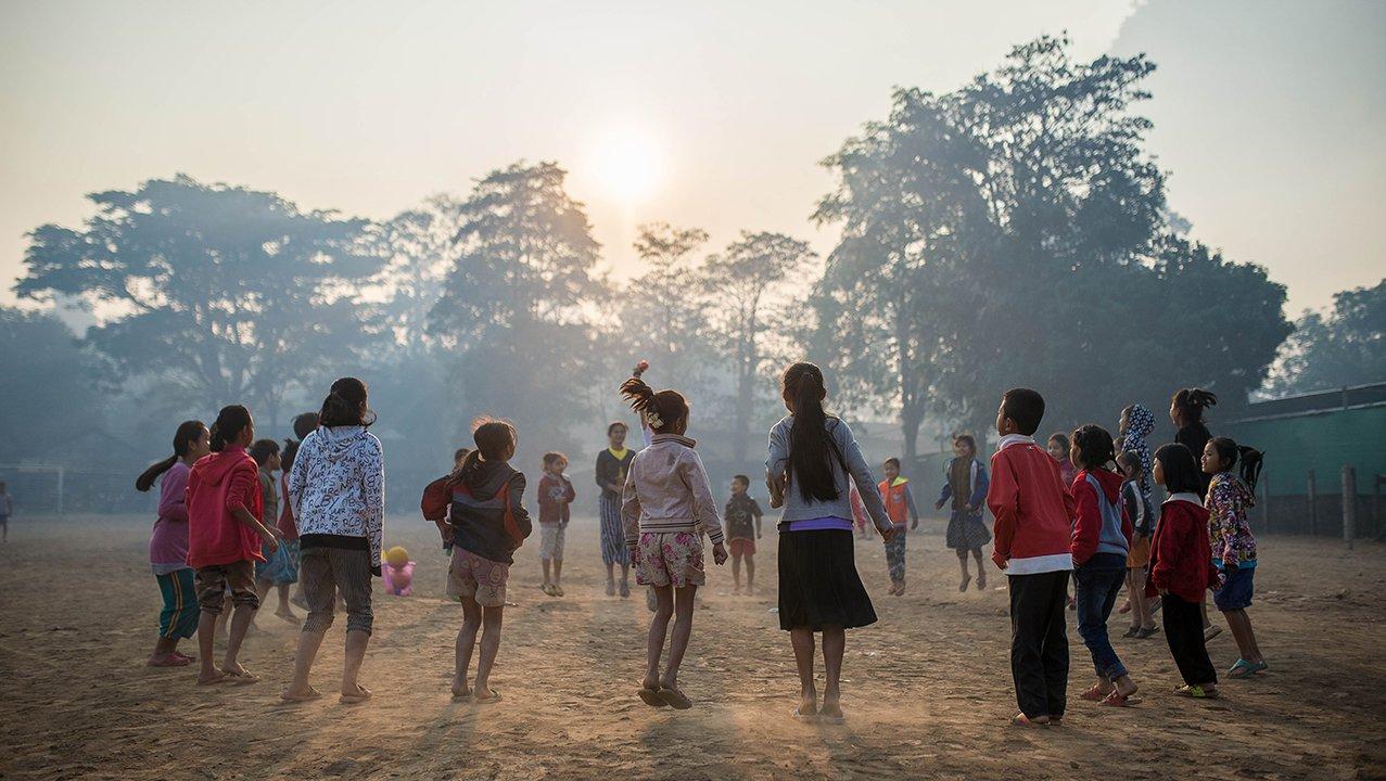 Thailand Kids jumping in circle at sunset