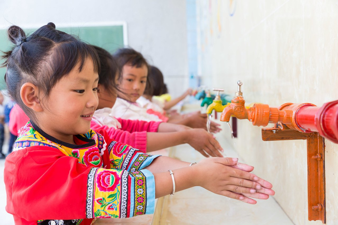 Girl in China practices handwashing